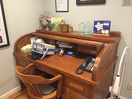 Dr. Harold's original roll-top desk still in use.